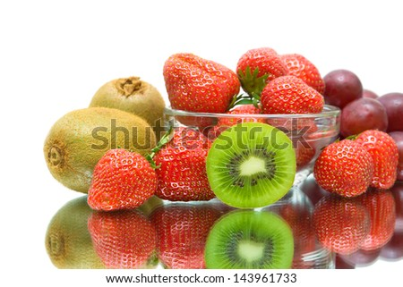 fruits and berries. kiwi, strawberry and grape close-up on a white background. horizontal photo.