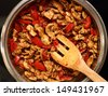 Frying Chicken and Pepper. Series - making tortilla with chicken and bell pepper. - stock photo
