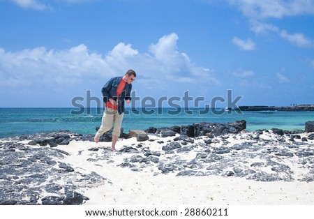 Fuerteventura, Canary islands, bach of black volcanic stone and white sand at el Cotillo, amateur photographer looking for something to photograph