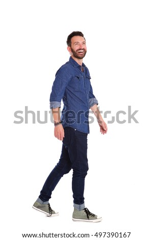 Full body portrait of cheerful mature man walking over white background