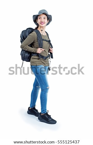 Full body shot of a walking lady hiker. Isolated in white background.