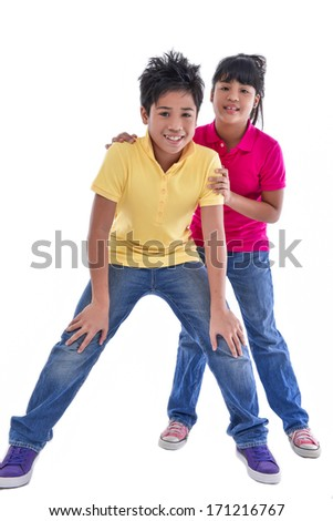 Full body Young brother and sister posing on white background