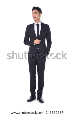 Full body young businessman standing with his hands in the pockets.
