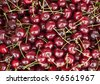 full frame, close up image of cherries on display at a Farmer's Market - stock photo