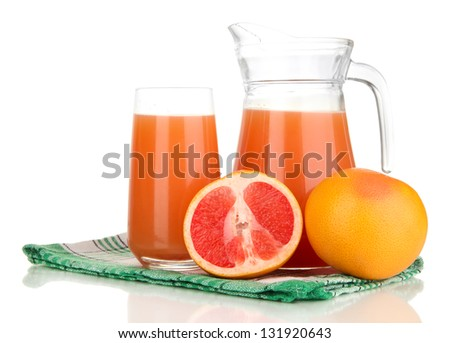 Full glass and jug of grapefruit juice and grapefruits isolated on white