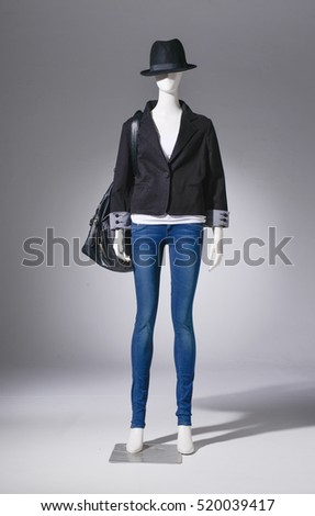 full-length female in jeans with hat on mannequin in light background