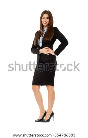 Full length of a confident young business woman isolated on white background
