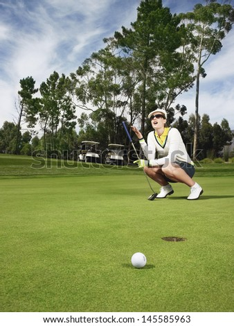 Full length of disappointed female golfer on putting green