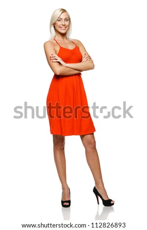 Full length of happy young woman standing with her hands folded against white background