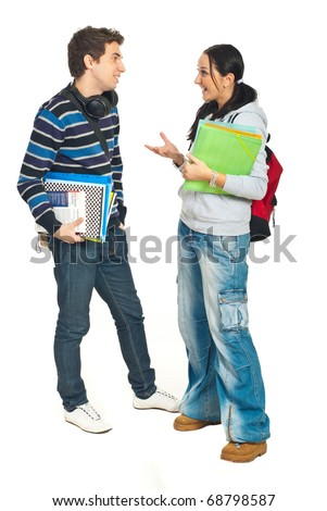 Full length of students couple having conversation isolated on white background
