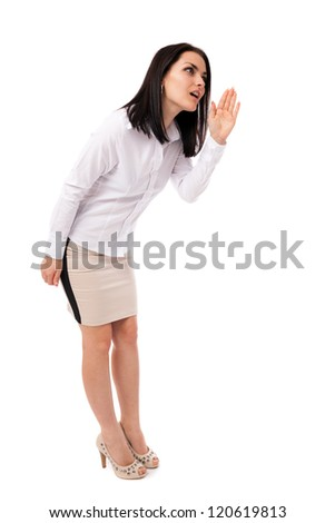 Full length portrait of a beautiful young businesswoman telling a secret isolated on white background