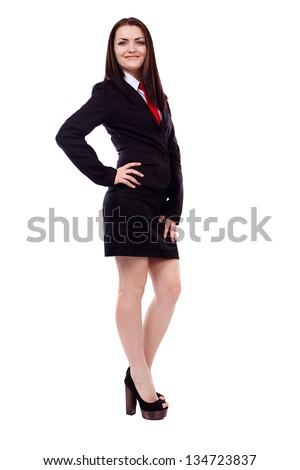 Full length portrait of a businesswoman standing with hand on hip isolated on white background