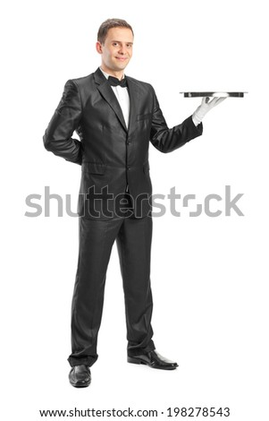 Full length portrait of a happy waiter holding a tray isolated on white background