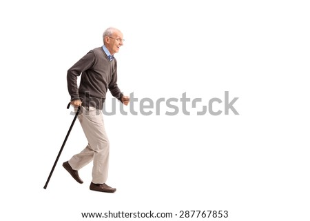 Full length portrait of a rushing senior walking fast isolated on white background