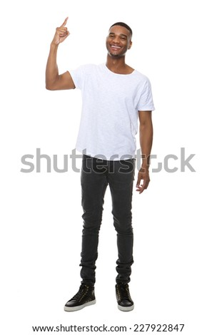 Full length portrait of a smiling man pointing finger showing copy space