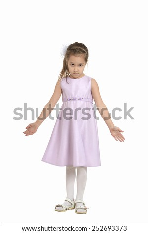 Full length portrait of an adorable little girl with pink dress standing over white background