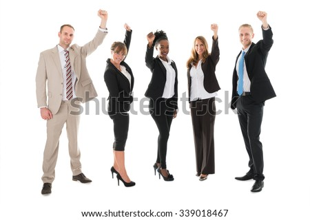 Full length portrait of happy business team celebrating success against white background