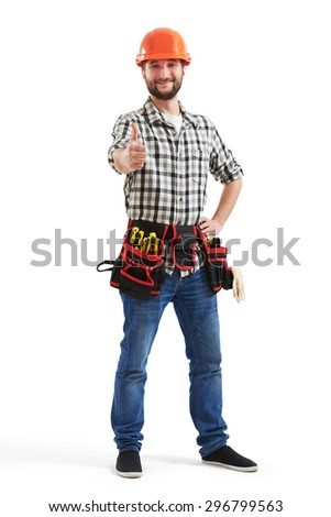 full-length portrait of smiley workman with tools in orange helmet showing thumbs up. isolated on white background