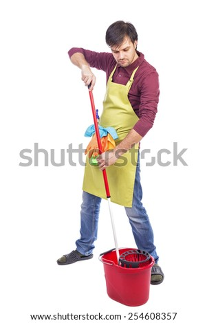 Full length portrait of young man ready to mop the floor against white background