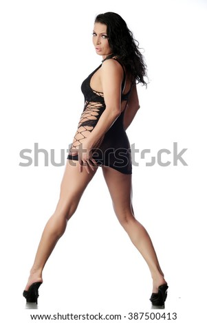 Full-length seductive woman in lingerie on white background studio