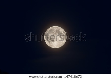 Full moon on deep blue sky as seen from Sweden during summer