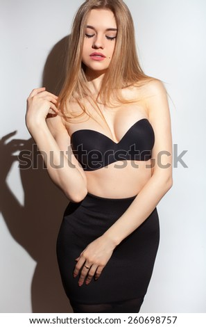 Full portrait of the beautiful young sexy woman with long blond