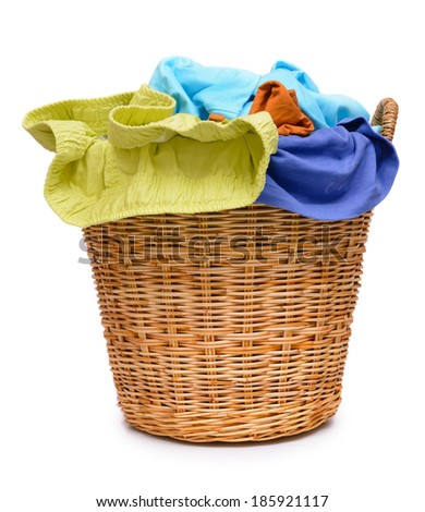 Full wicker laundry basket  isolated on white background