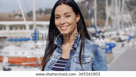 Fun attractive woman smiling at the camera