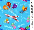 Fun seamless pattern made of all kinds of colorful candy including lollipops over blue background with candy and bonbon text. - stock vector
