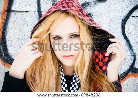 Funky and pretty girl with red cap plaid