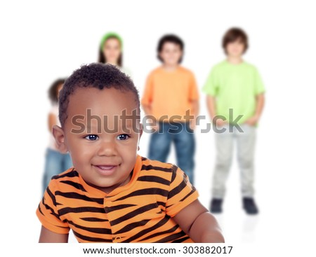 Funny afroamerican baby with other children unfocused of background