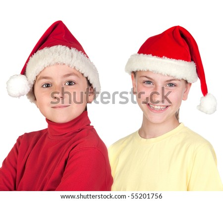 Funny child and smiling preteen with Santa Claus hat isolated on a over white background