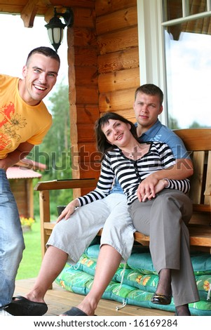 funny friends relaxing in summer cottage