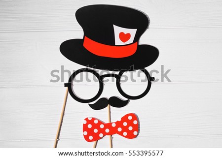 funny gentleman face created from wedding props glasses, mustache and hat