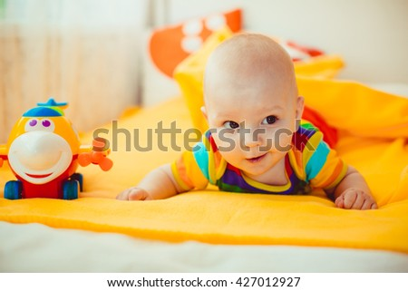 Funny kid with a toy