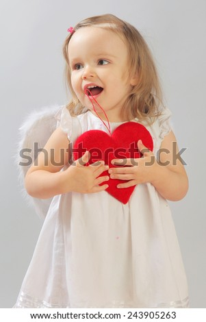 funny little angel with white wings