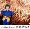 Funny little boy simulating electric shock with many sparks - stock photo