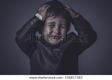 funny little business boy over grey background