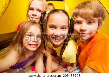 Funny portrait of five kids in a tent