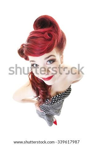 Funny, smiling, red-headed pinup girl.  Shot on white background.