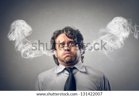 furious businessman with smoke coming out of his ears