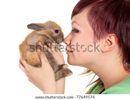 Furry rabbit held by an attractive teenager girl