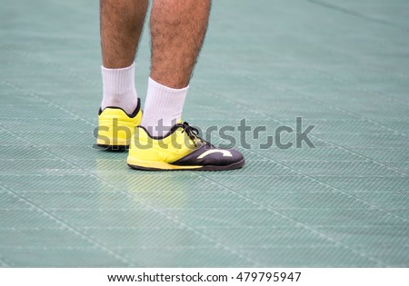 futsal player standing on plastic field ready to play