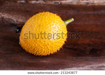 Gac,Baby Jackfruit Spiny Bitter Gourd, Sweet Gourd.A Southeast Asian fruit isolate on wood.