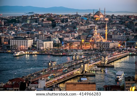 Galata Bridge on the Golden Horn, with Emin�¶n�¼ in the background, as seen from the Galata Tower. At the dusk, Turkey, Istanbul.