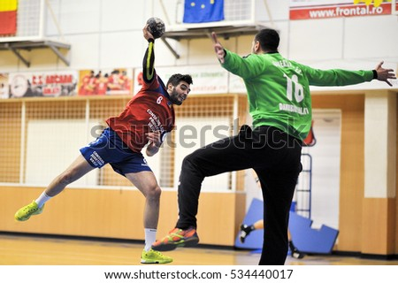 GALATI, ROUMANIA - MARCH 19: Unidentified players in action at Roumanian Handball National Championship . match (HC Danubius Galati vs. HC Vaslui) March 19, 2016 in Galati, Roumania.