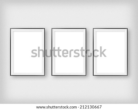 gallery interior with three empty frames on wall