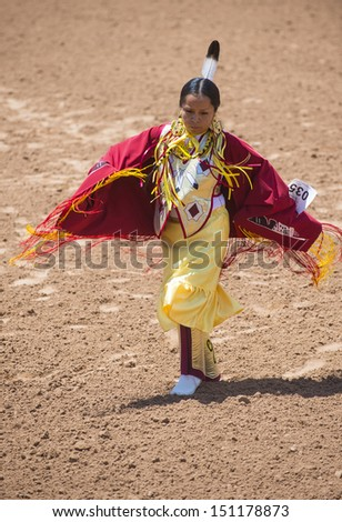 GALLUP , NEW MEXICO - AUGUST 10 : An unidentified Native American takes part at the opening ceremony of the 92nd annual Indian Rodeo in Gallup, NM on August 10 2013