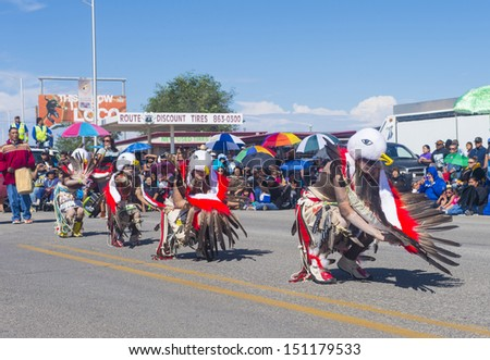 GALLUP , NEW MEXICO - AUGUST 10 : Native Americans with traditional costume participates at the 92 annual Inter-tribal ceremonial parade on August 10 , 2013 in Gallup New-Mexico