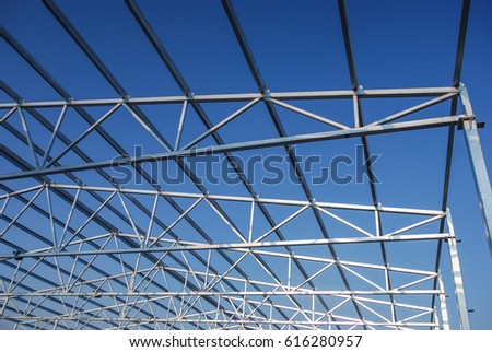 Galvanized Steel Roof Truss Construction Frames With Deep Blue Sky In The  Background. Lightweight Roofing